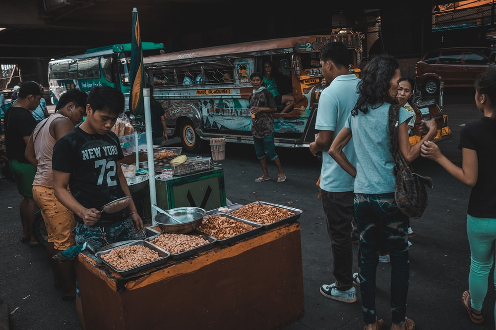 people near street foods stall
