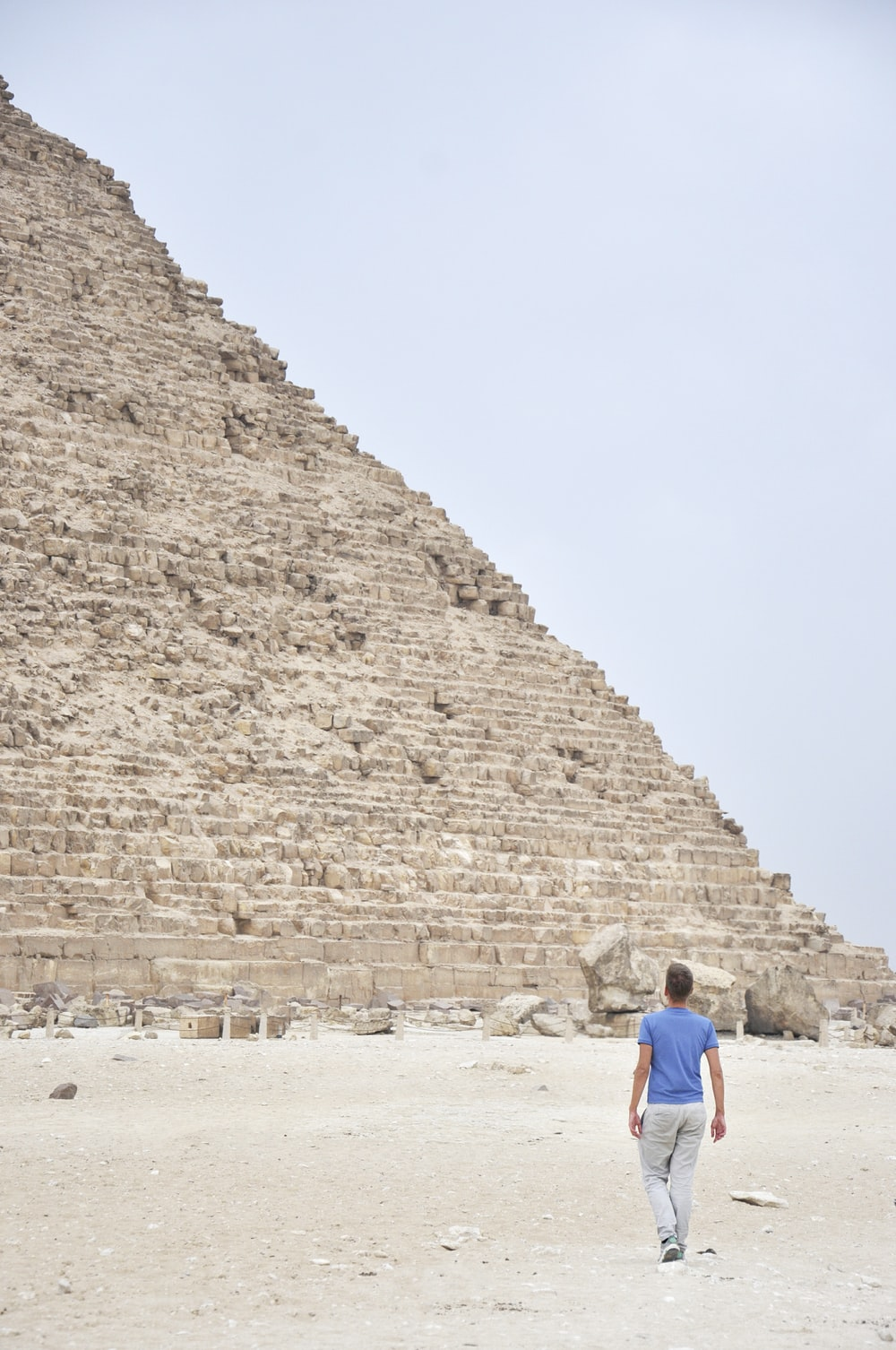 man standing near pyramid during daytime