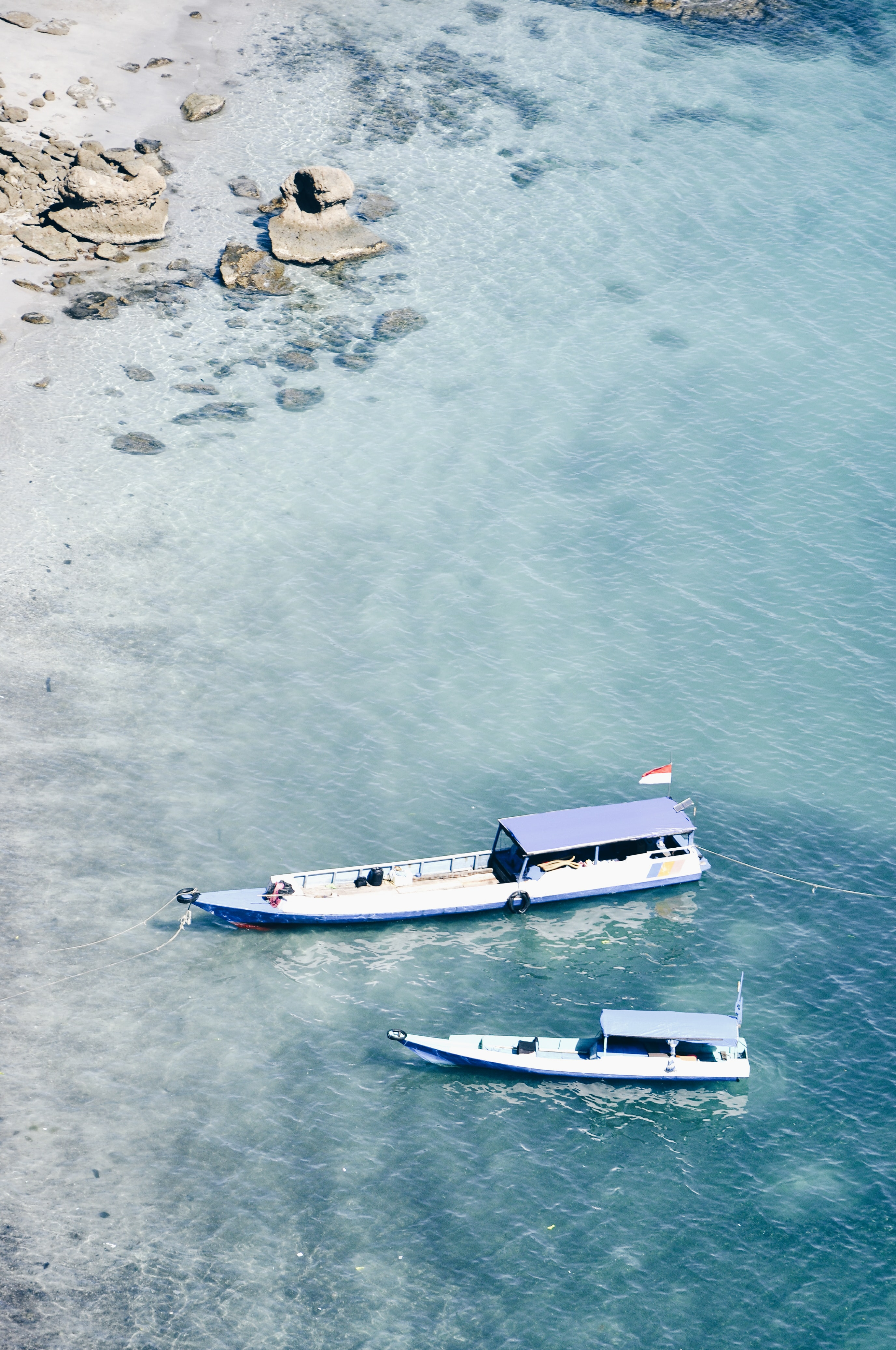 two motor boat on body of water at daytime