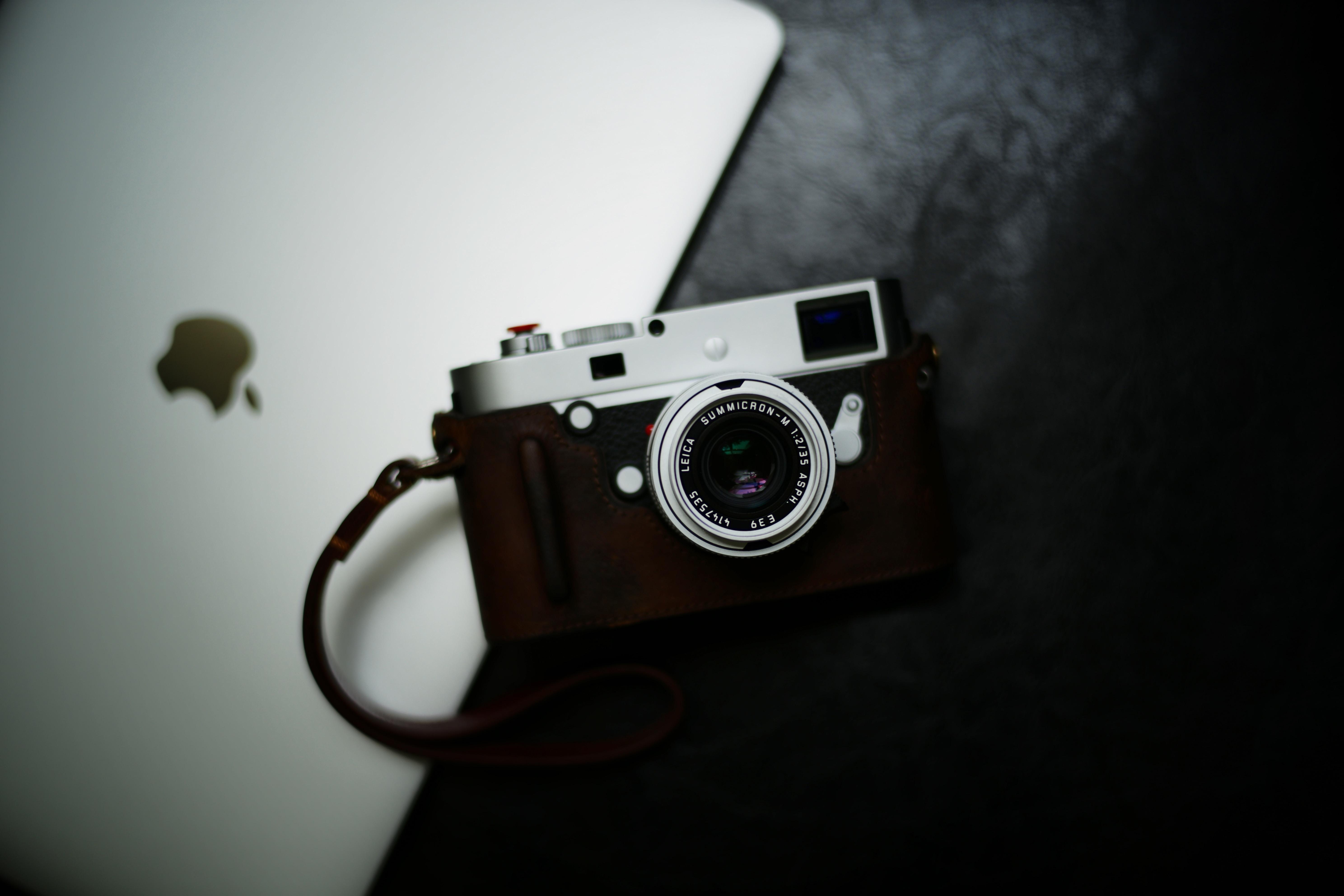 flat lay photography of camera near MacBook