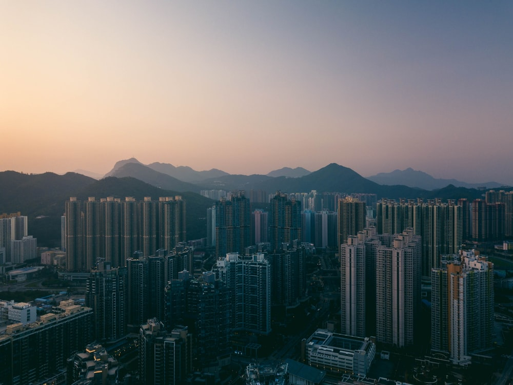 city buildings under orange sunset