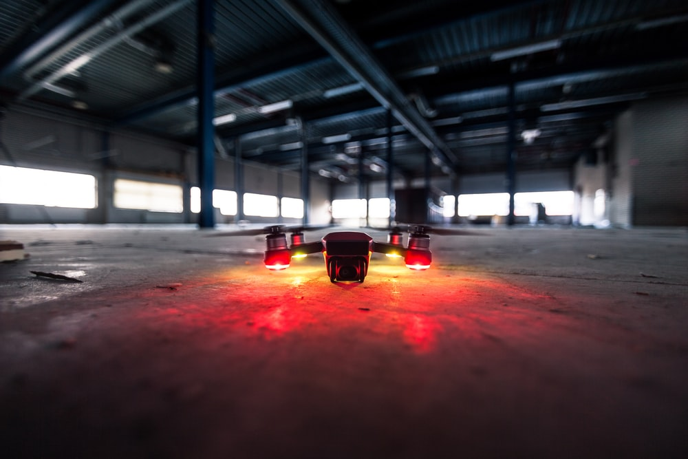 shallow focus lens photo of drone