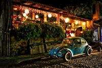 high-saturated photography of parked blue Volkswagen Beetle