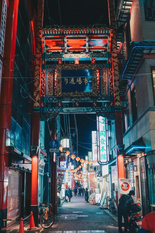 people walking on street in between buildings