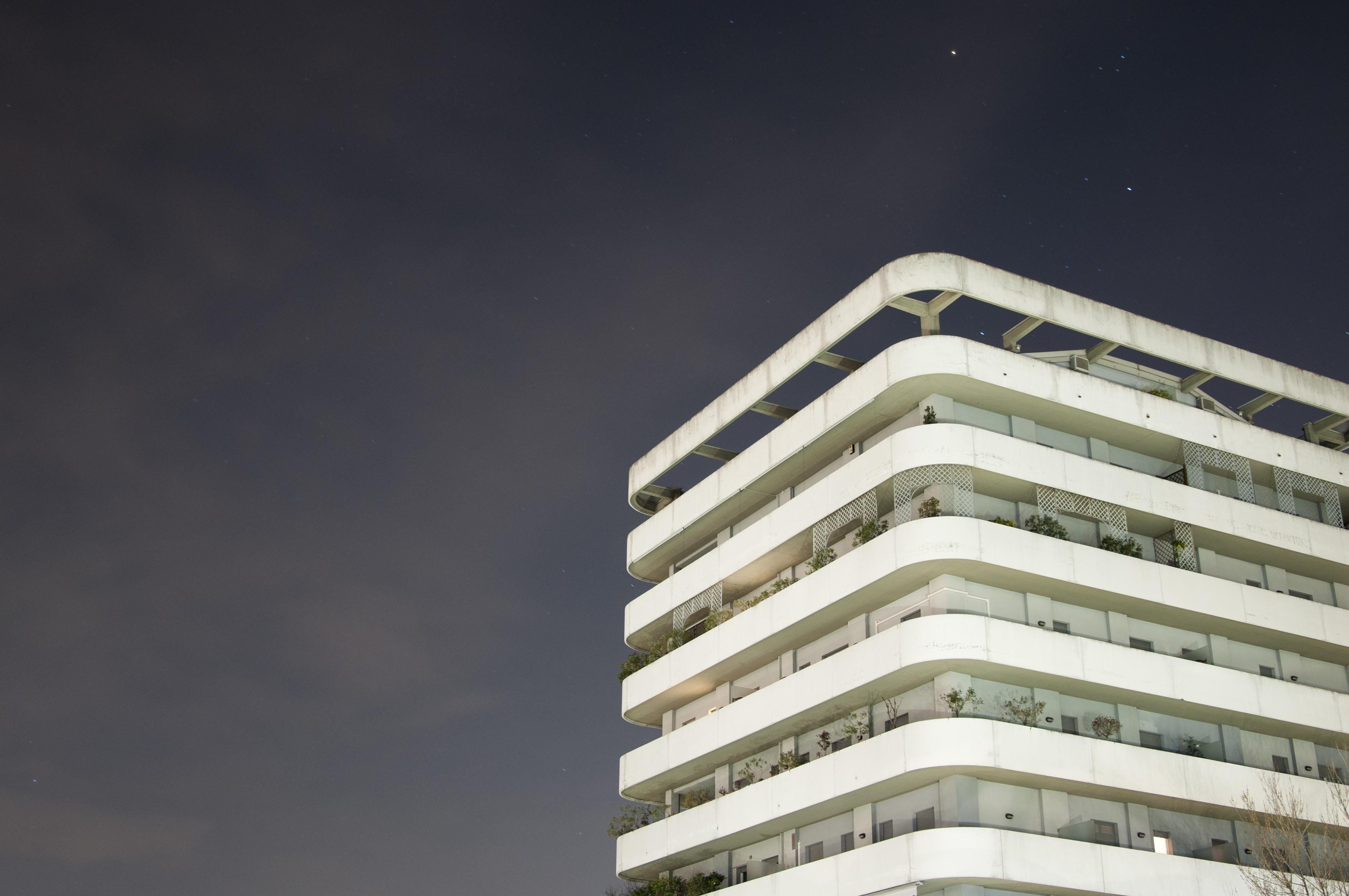 white concrete building at night photo