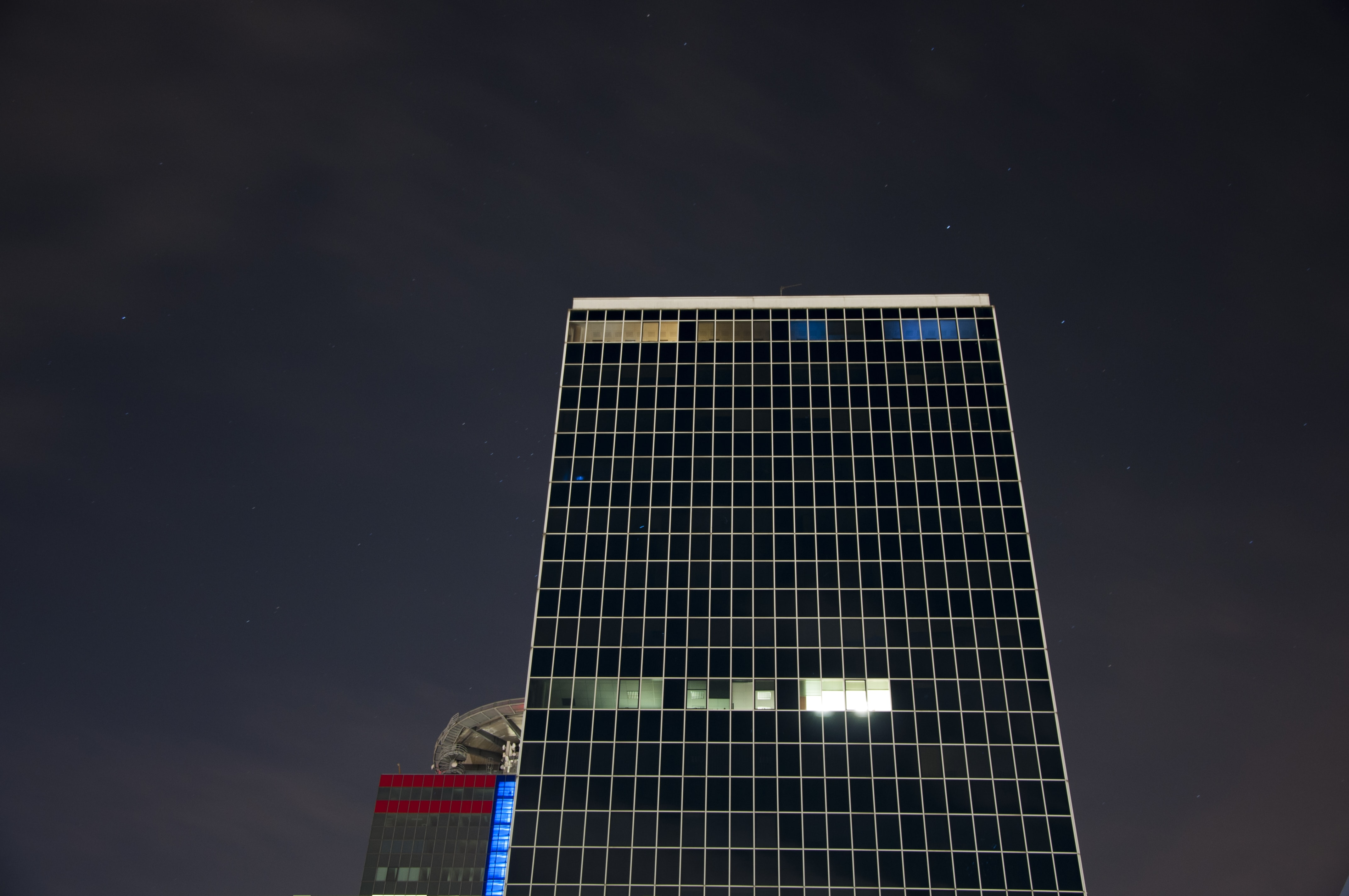 low-angle photo of high-rise building during night time