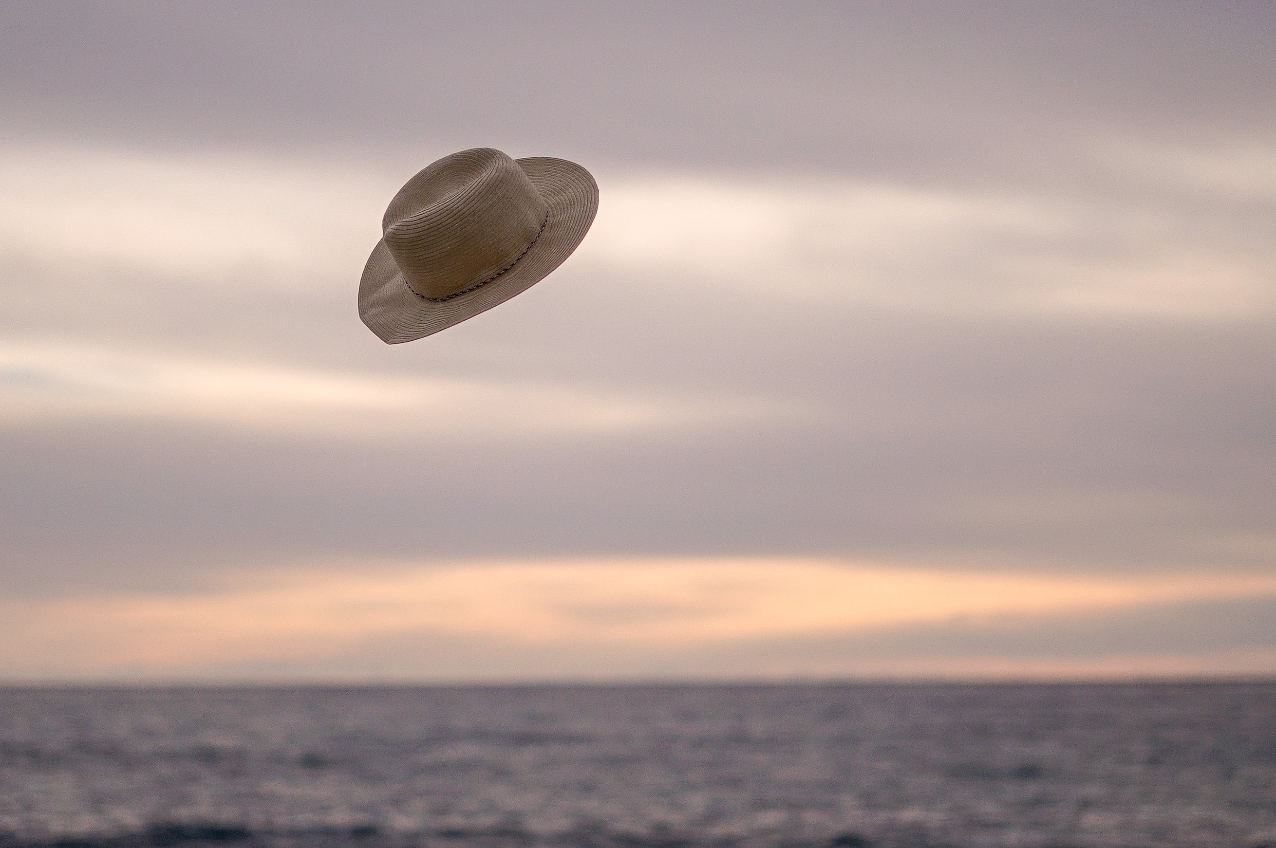 hat flying above the ocean during day time