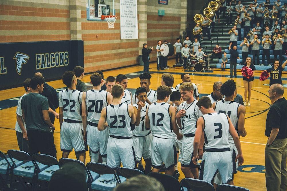 basketball team standing on courtside