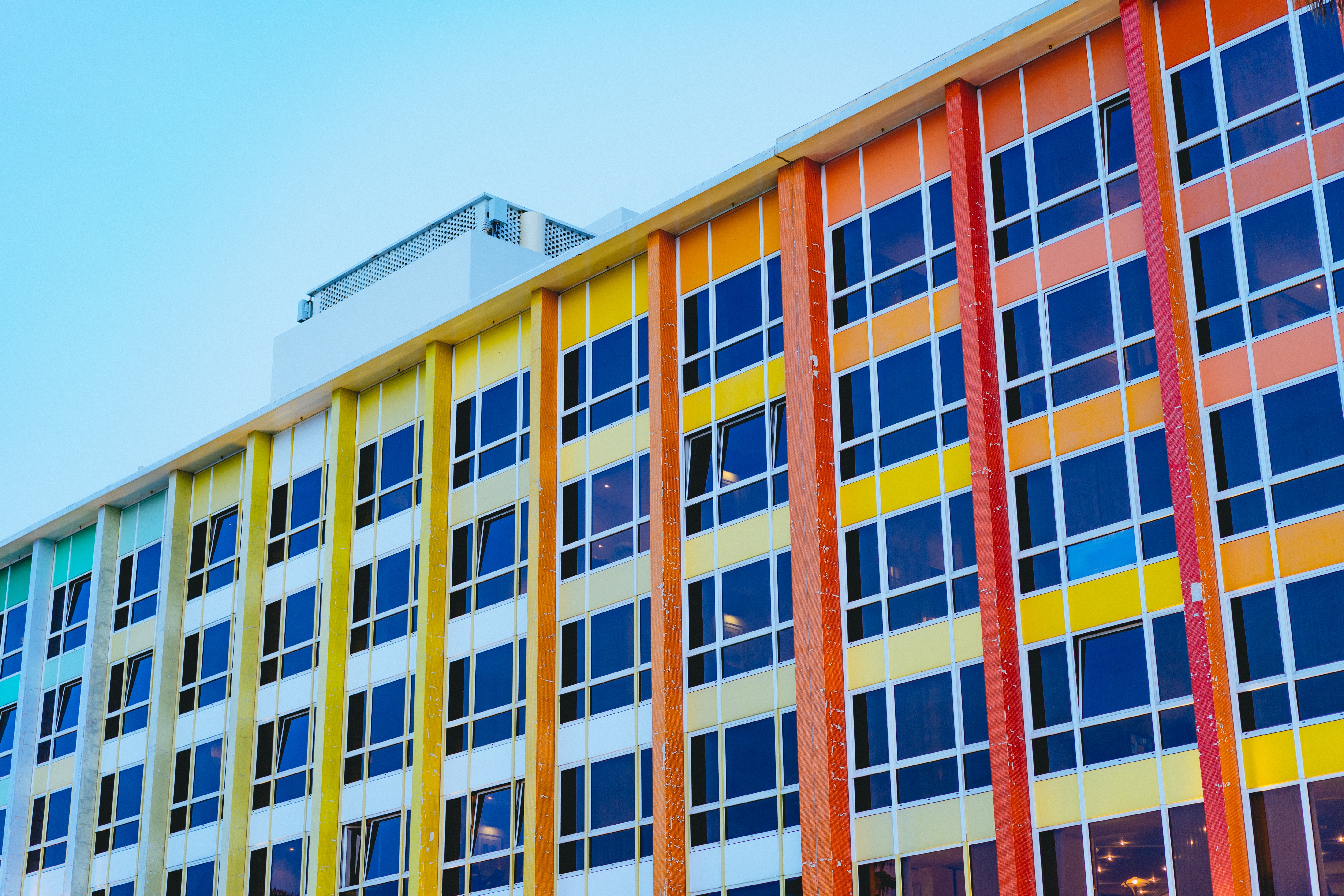 architectural photography of multicolored building under blue sky