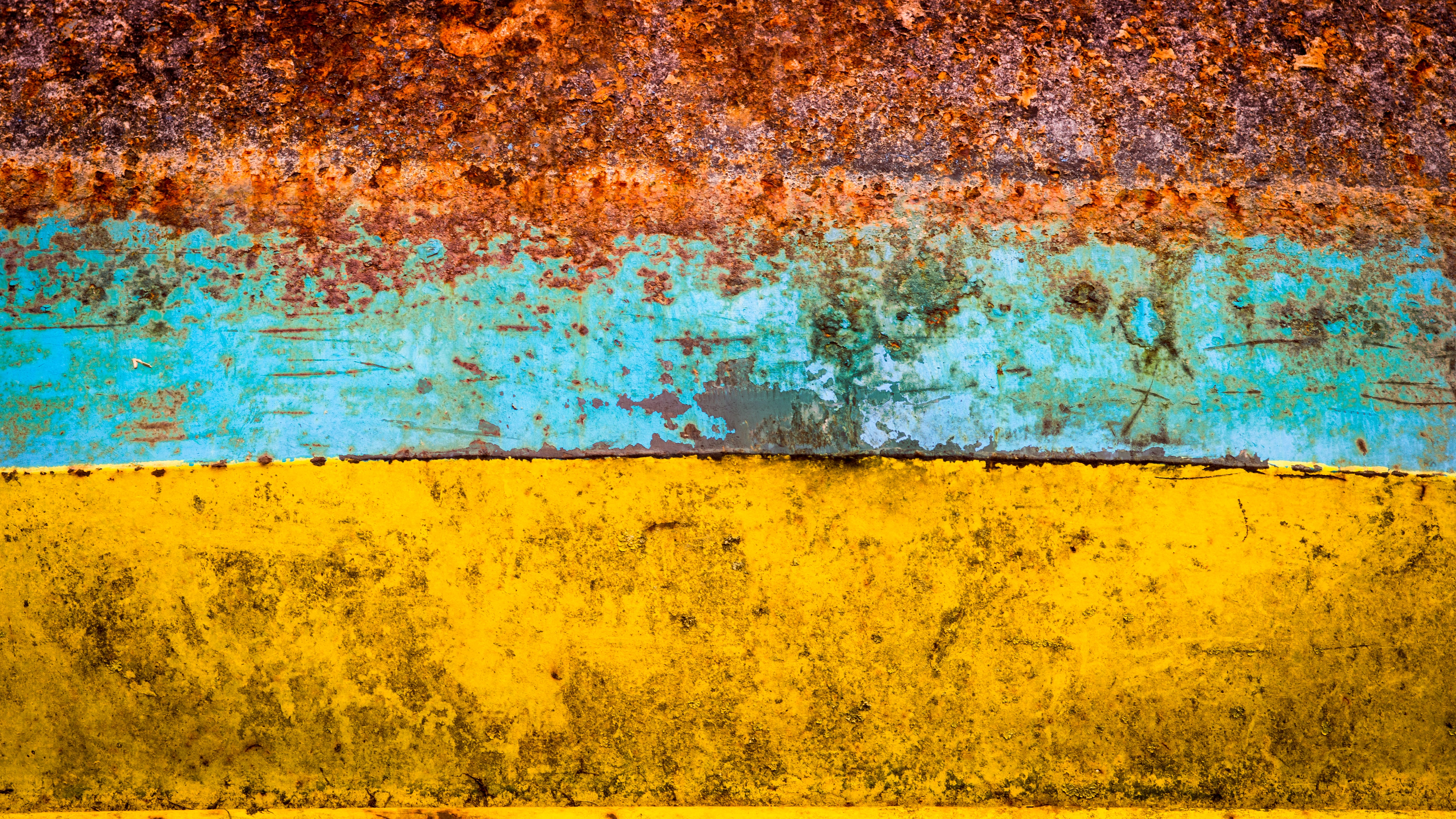 brown, blue, and yellow abstract painting