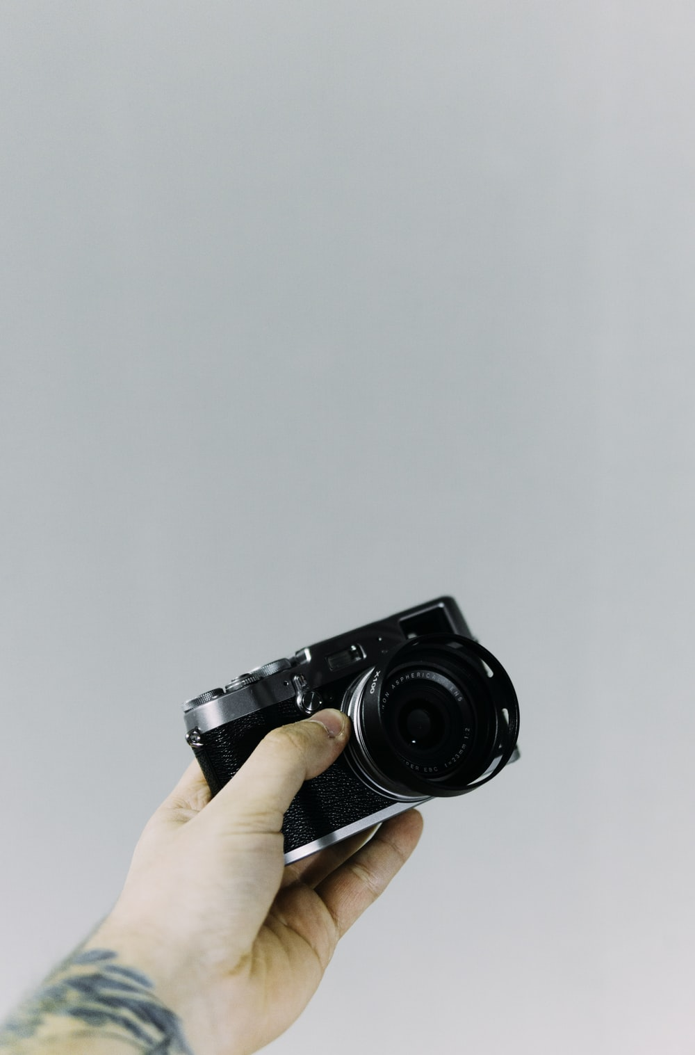 person holding black DSLR camera