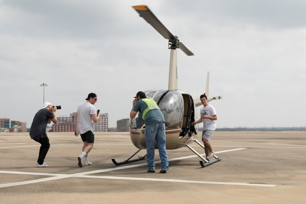 four men surrounding helicopter