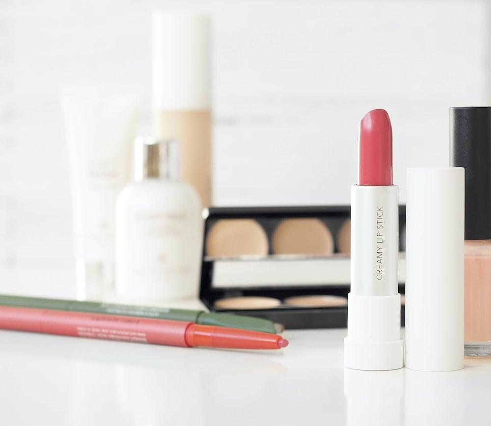 assorted-brand makeup lot on desk