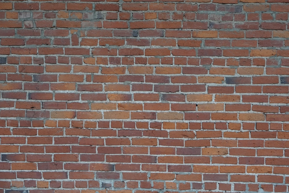view of red brick wall
