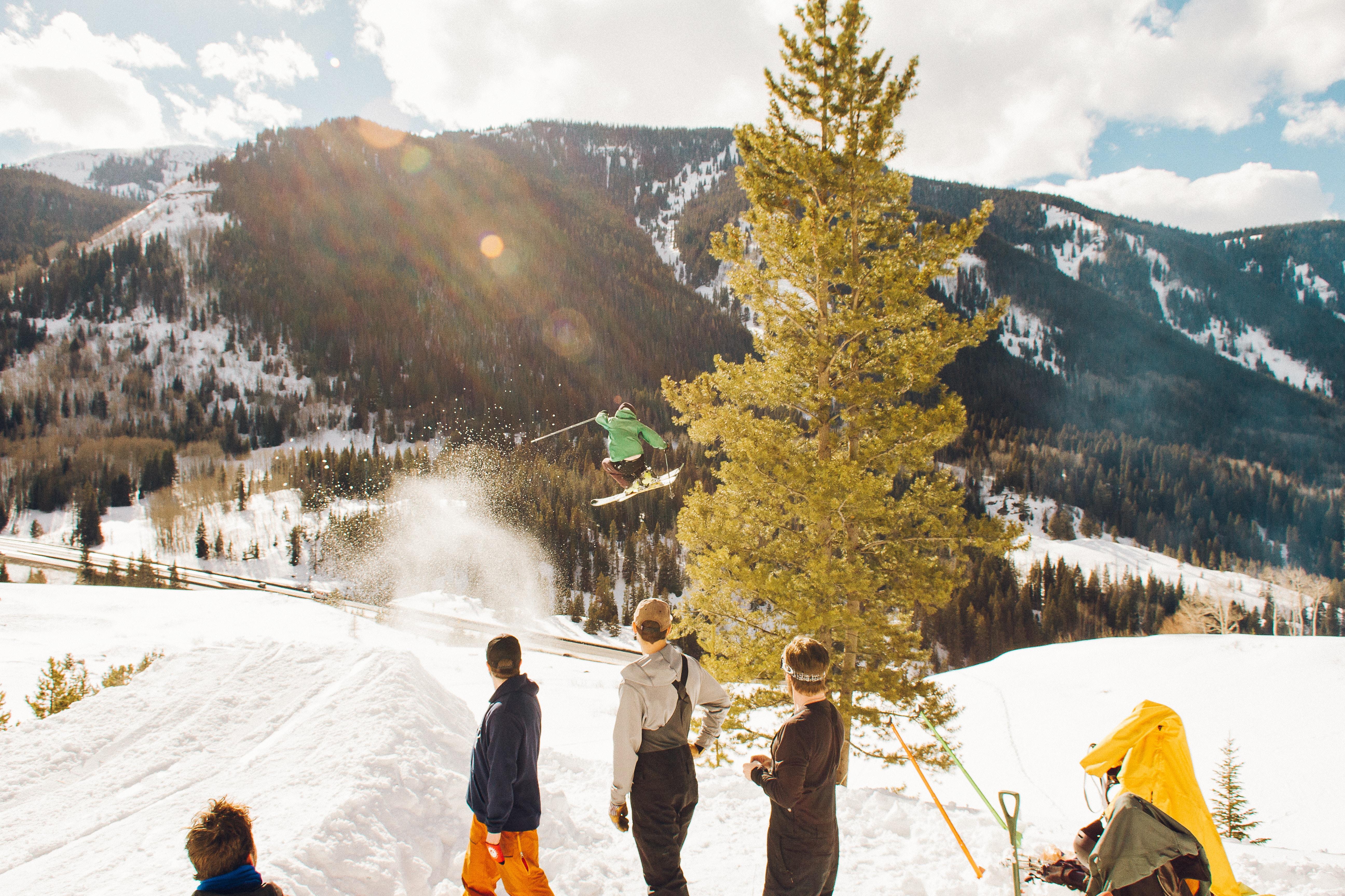 group of people on mountain peak during daytime