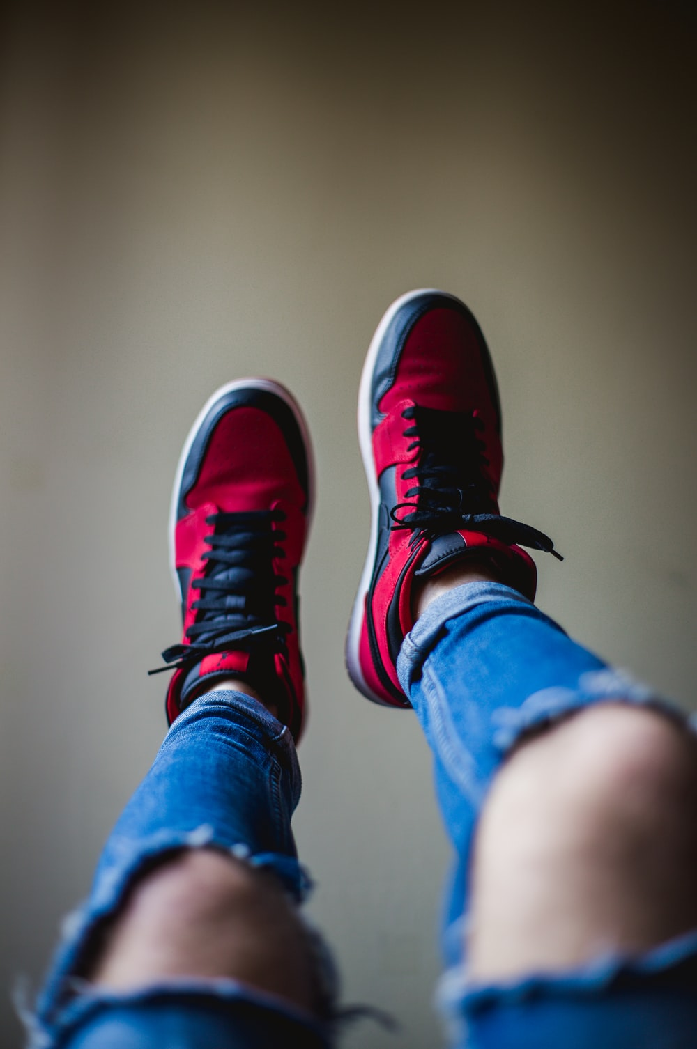 shallow focus photography of red-and-black shoes
