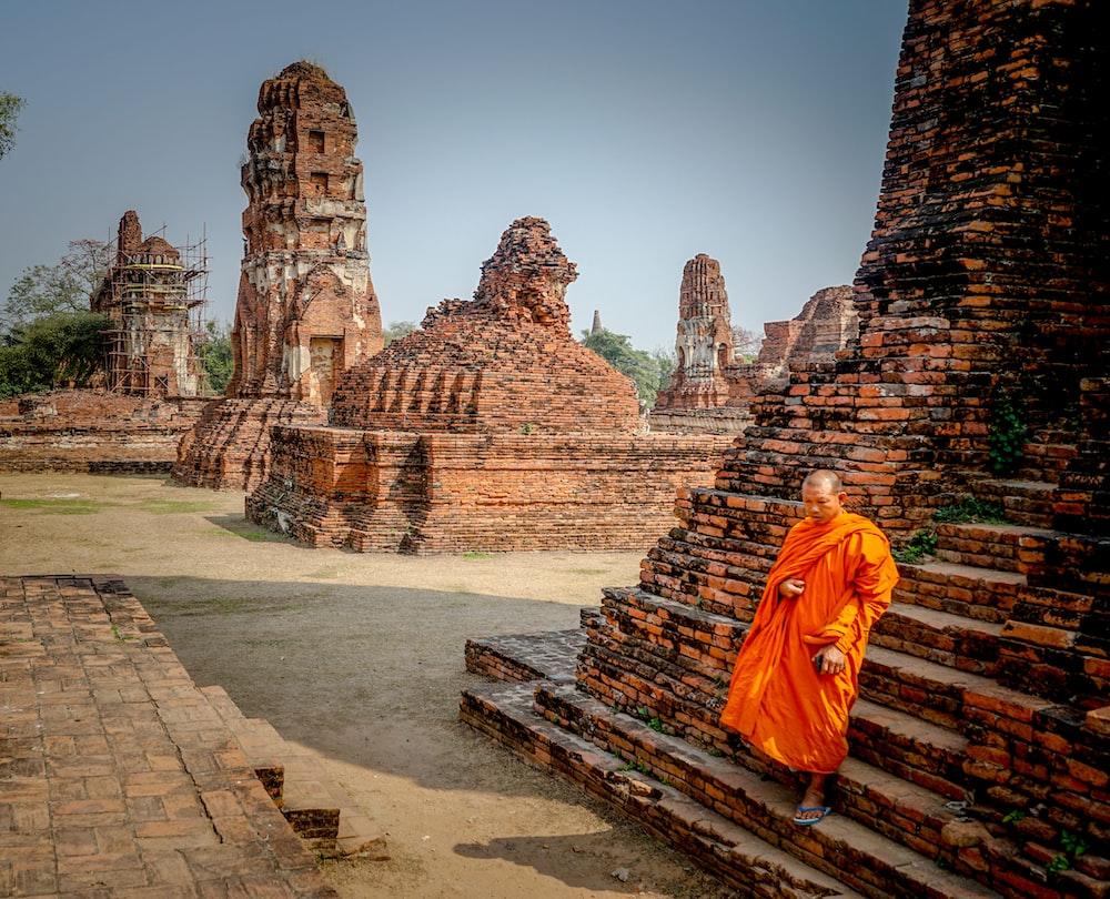 monk walking on brown stair