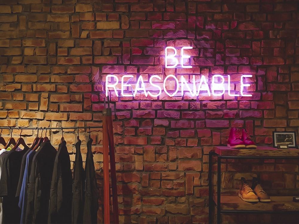 Be Reasonable neon signage