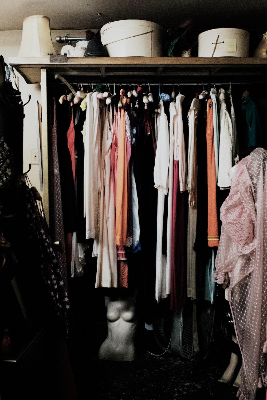 clothes hanged inside wardrobe