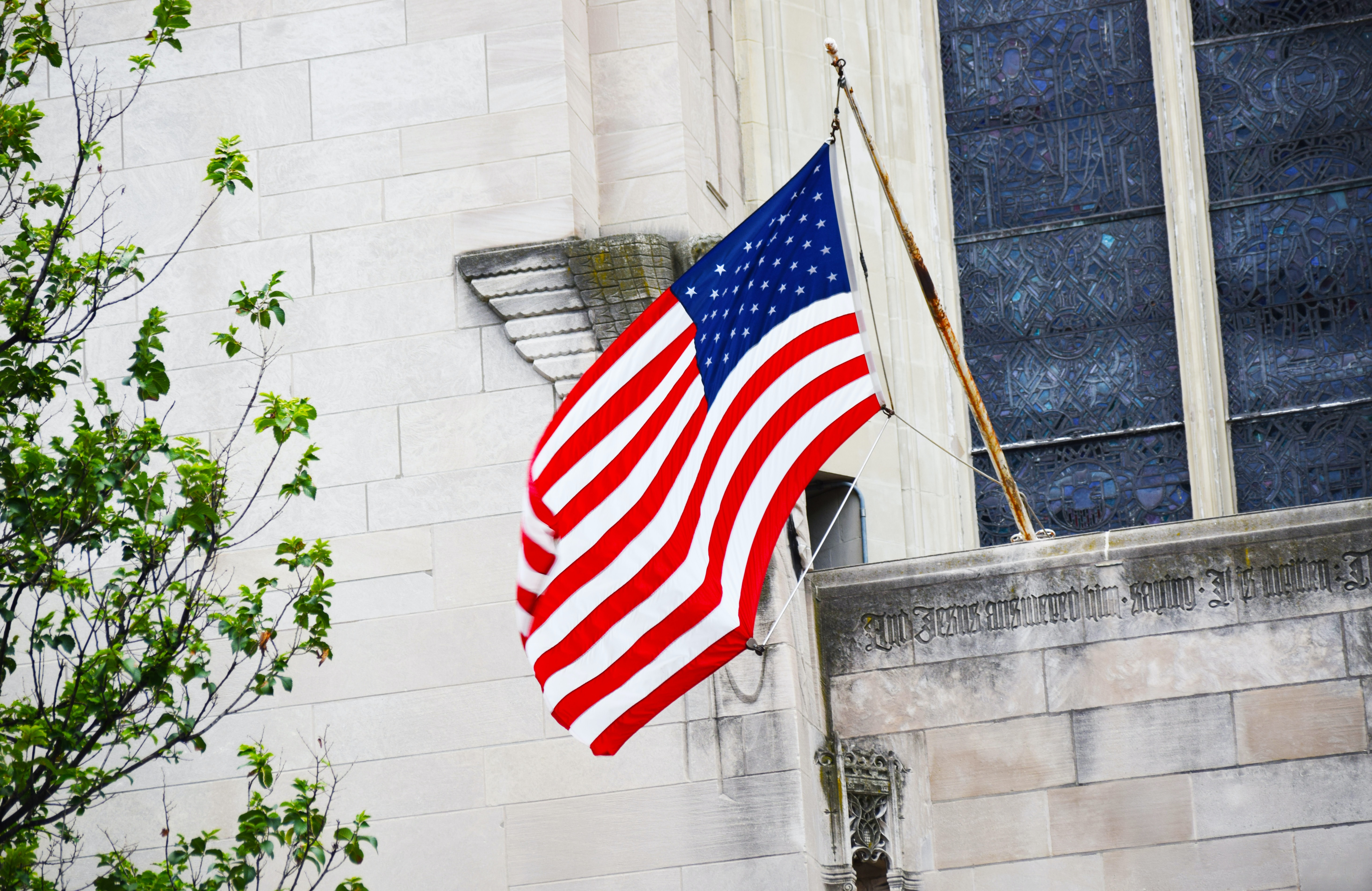 flag of USA mounted on building