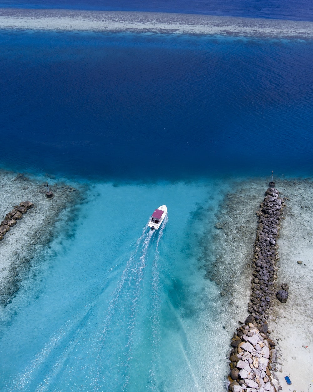 birds eye view of white boat on body of water