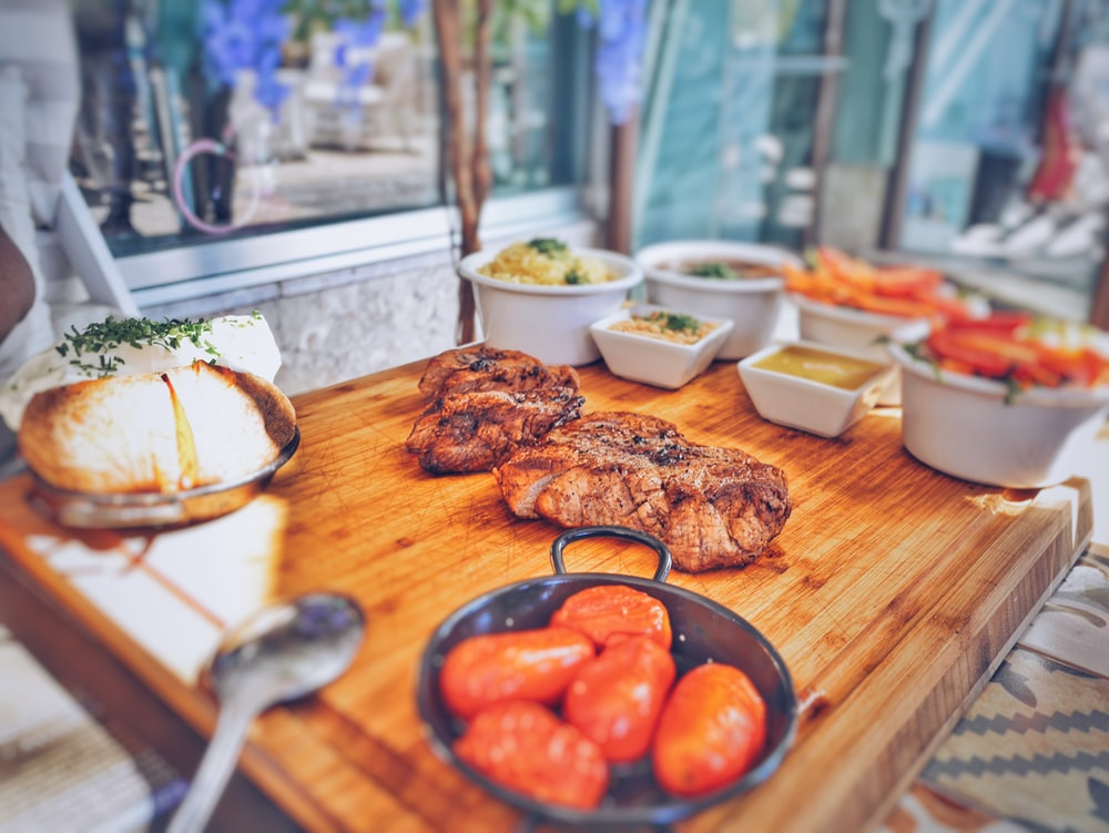 grilled meat on brown wooden tray