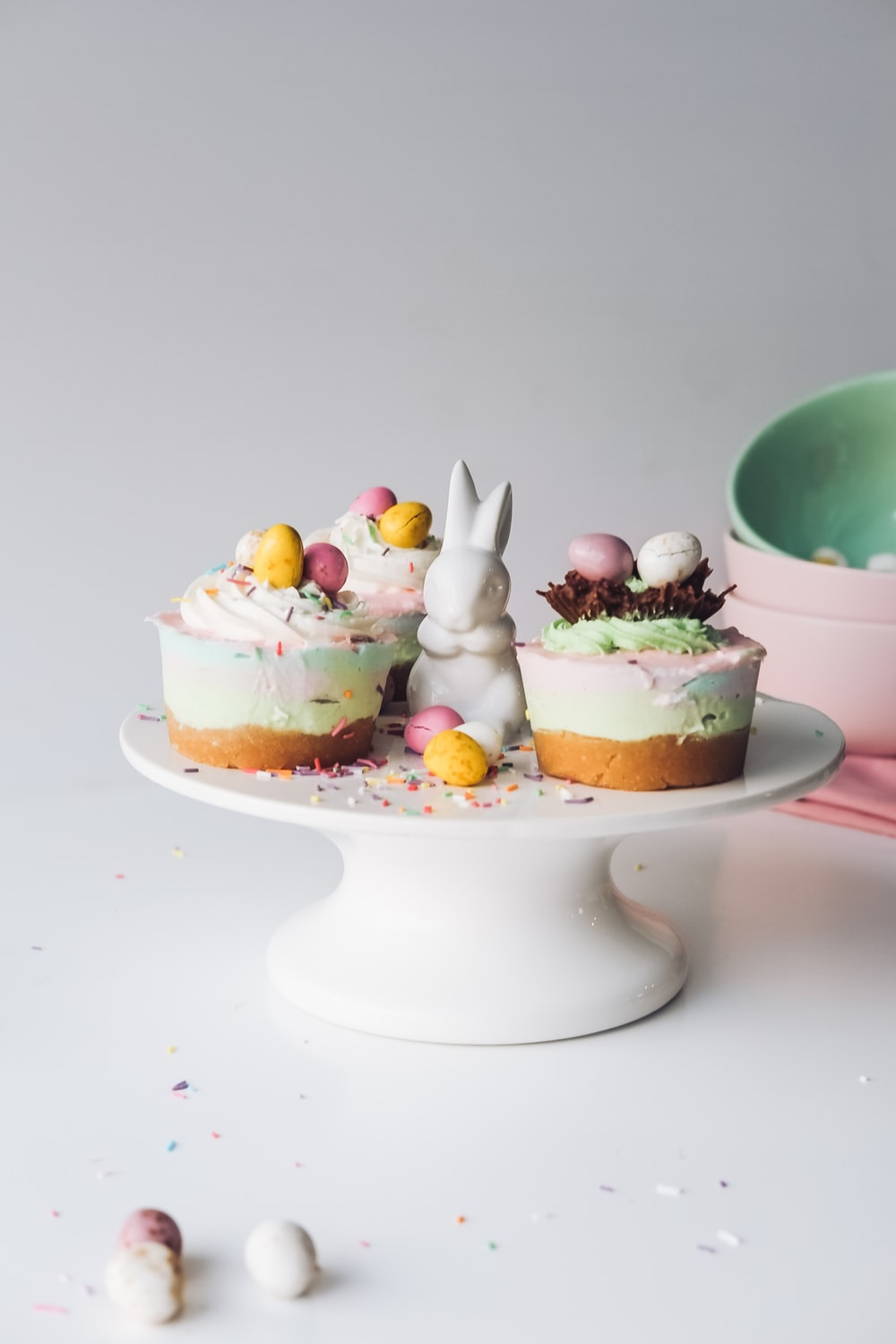 easter baking of cakes placed on white ceramic cake stand
