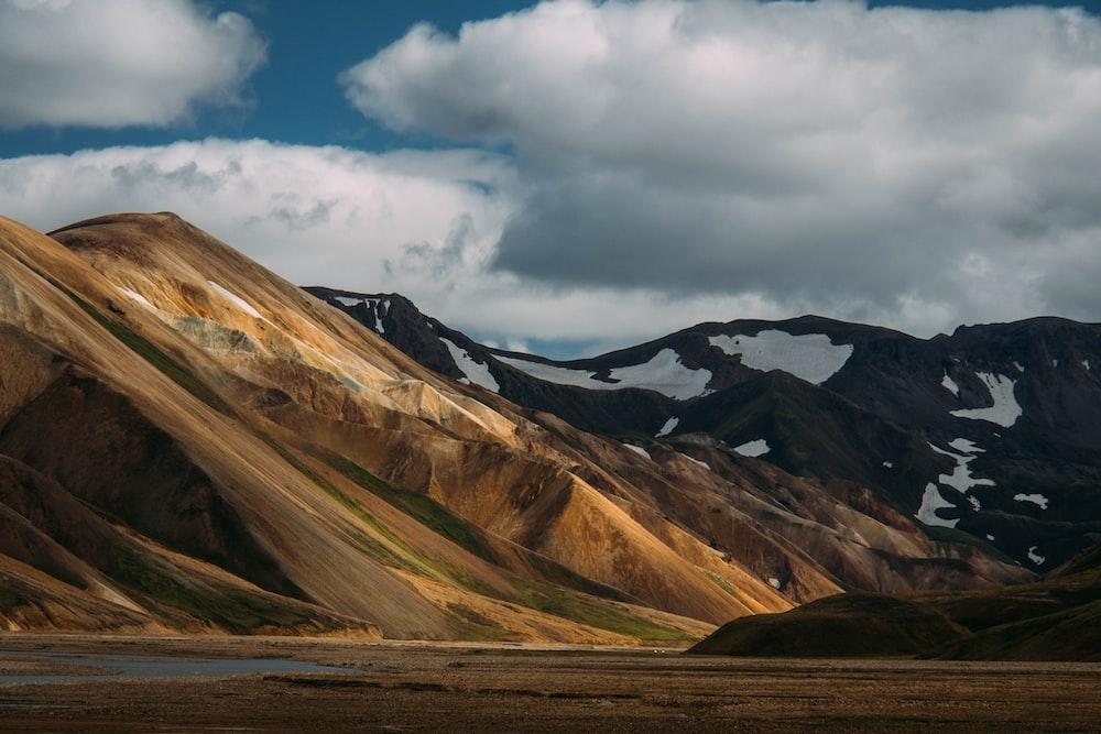 brown mountain and snowy terrain