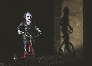 Jigsaw riding bicycle