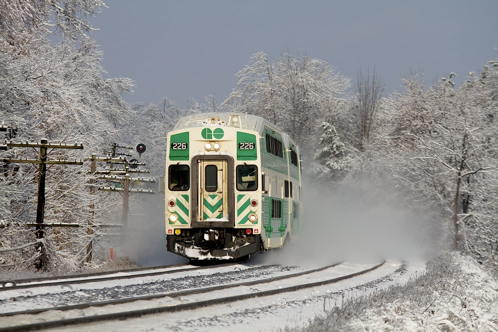 white and green train on railway during daytime
