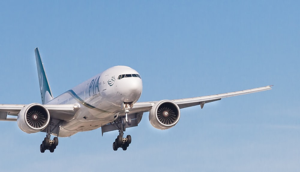 white PIA airplane