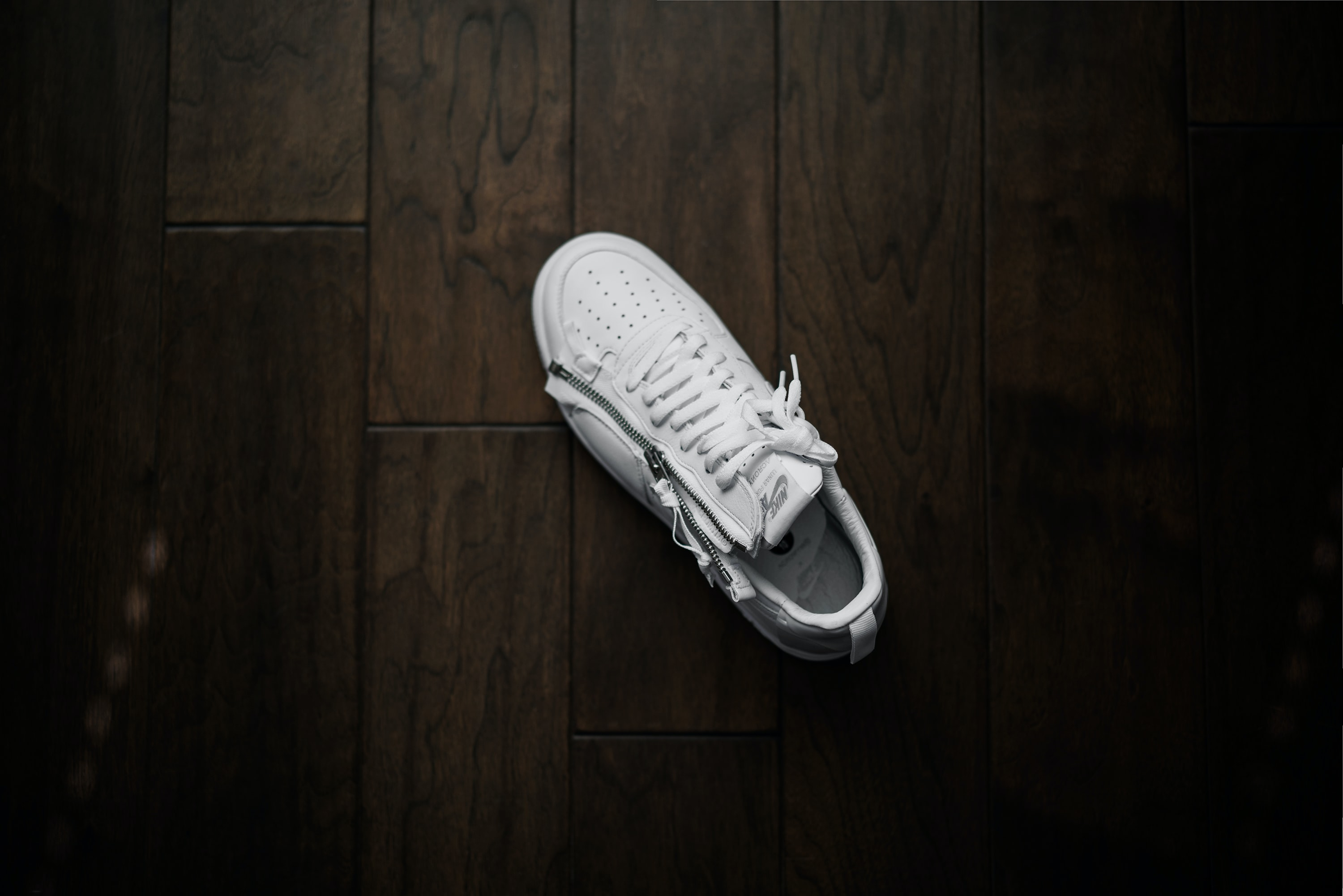 unpaired white Nike low-top sneaker