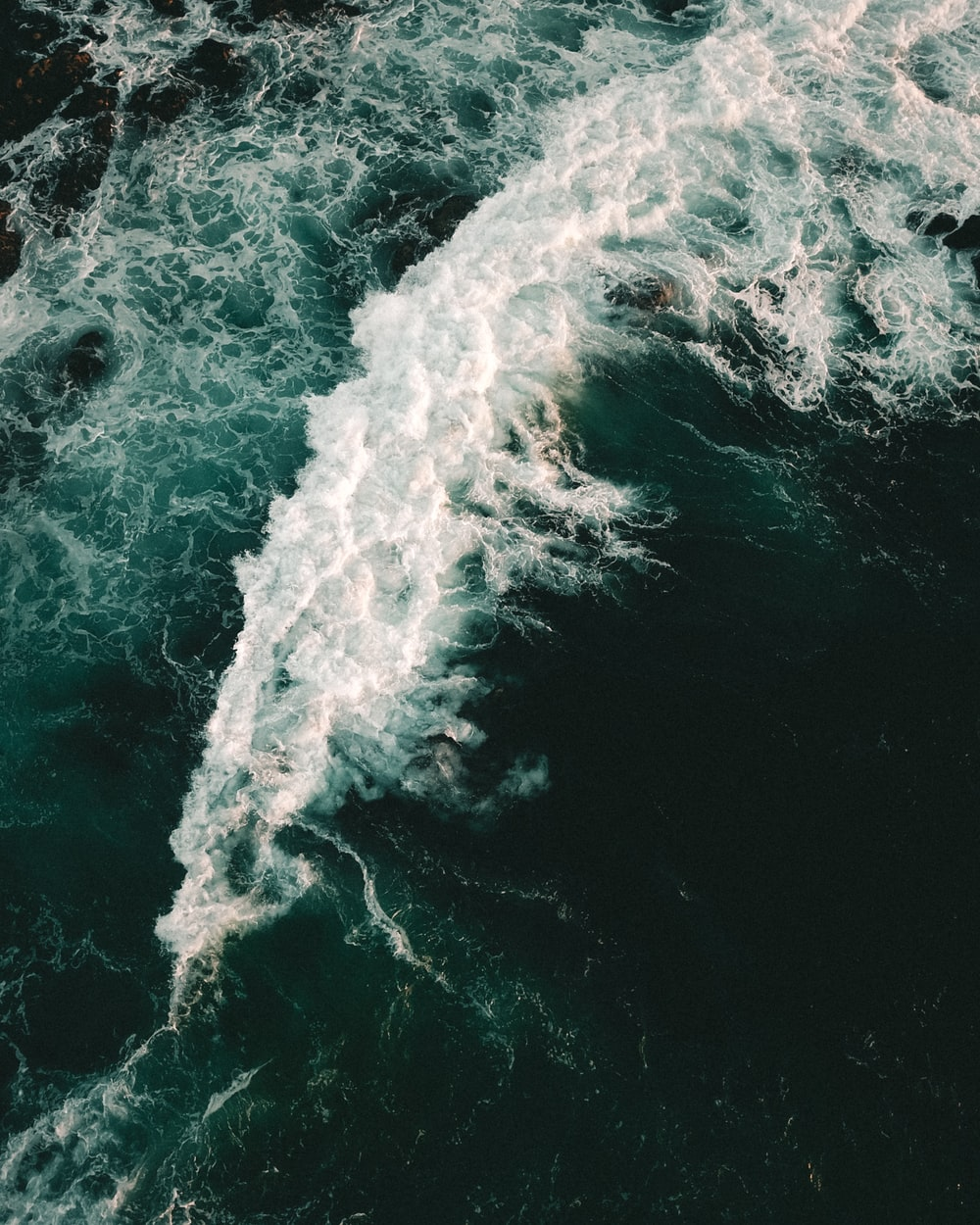 high angle photography of sea wave