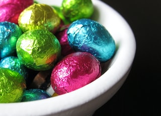 chocolate eggs in white bowl