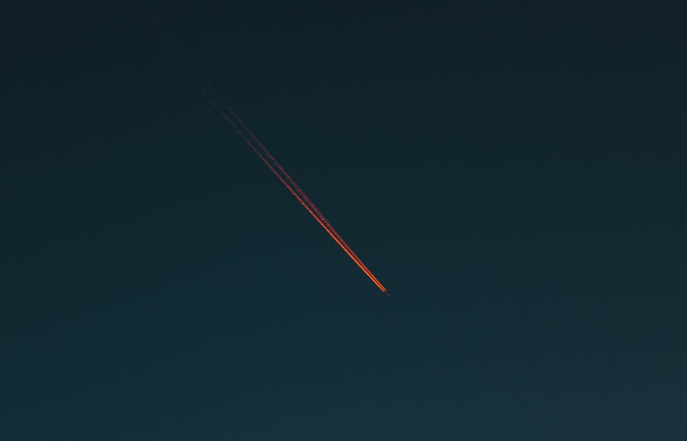 red smoke coming from plane