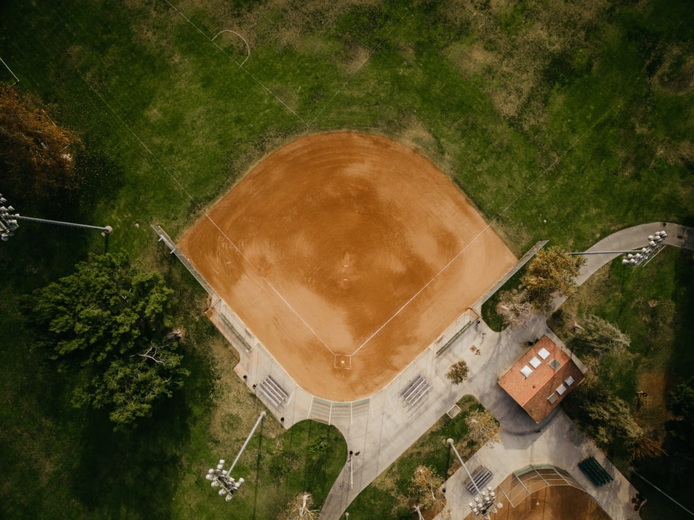 aerial photography of brown baseball field surrounded green field
