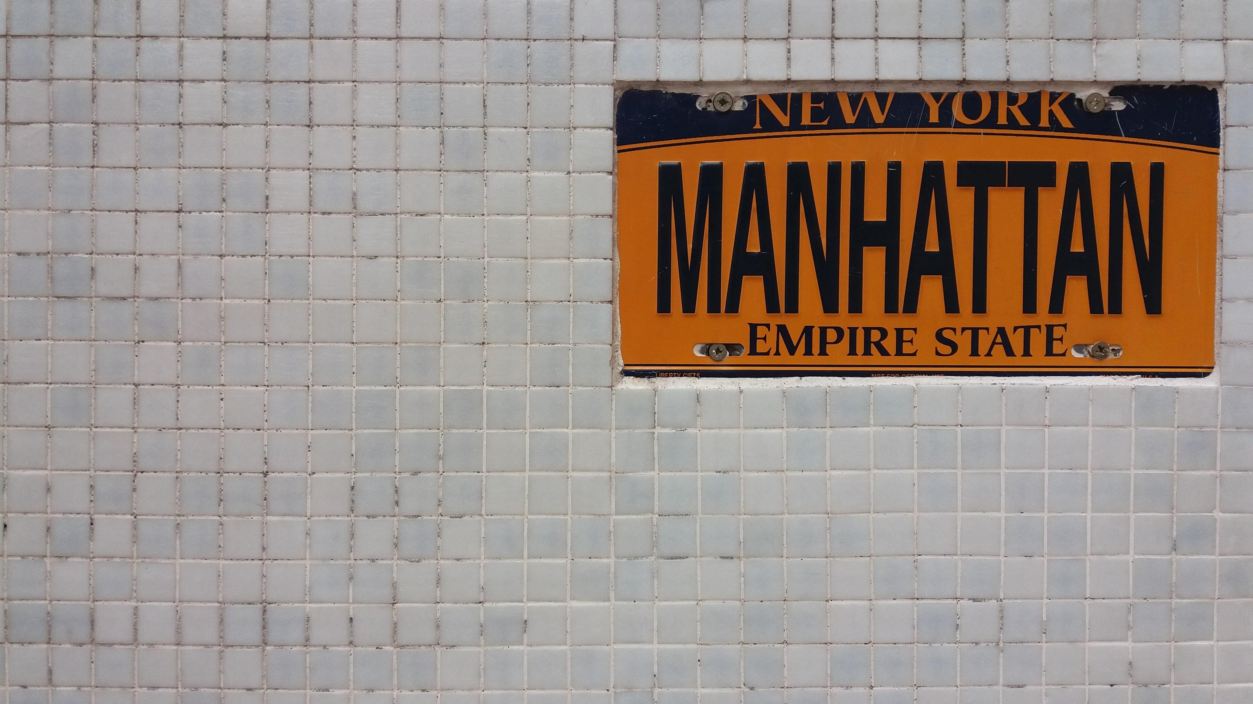 New York Manhattan license plate holder on wall