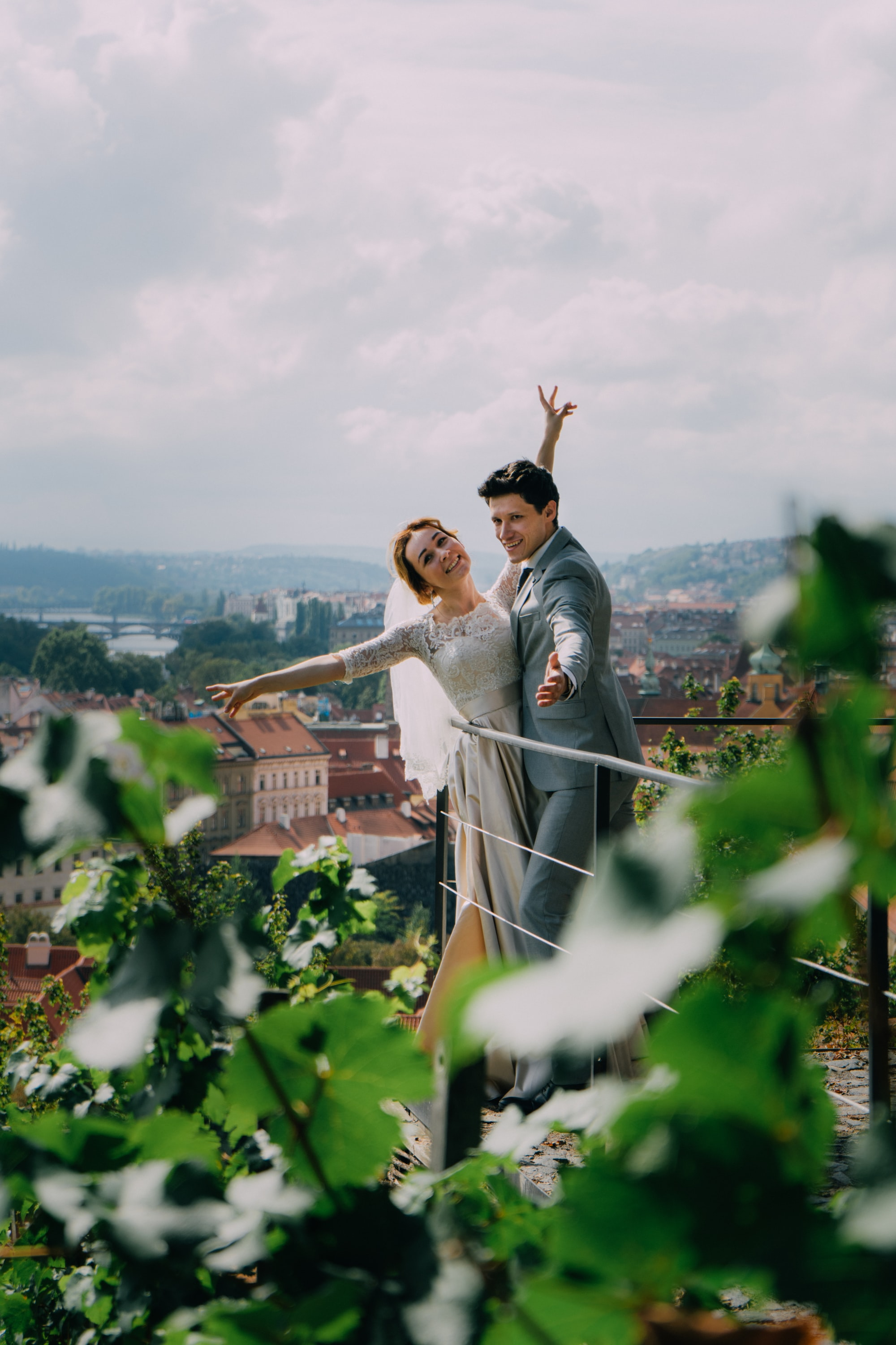 While visiting Prague castle, the cute couple were posing for pictures on the top of the city, in Prague castle's entrance.