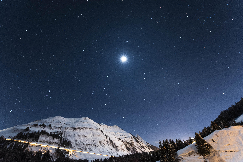 white mountain under starry night