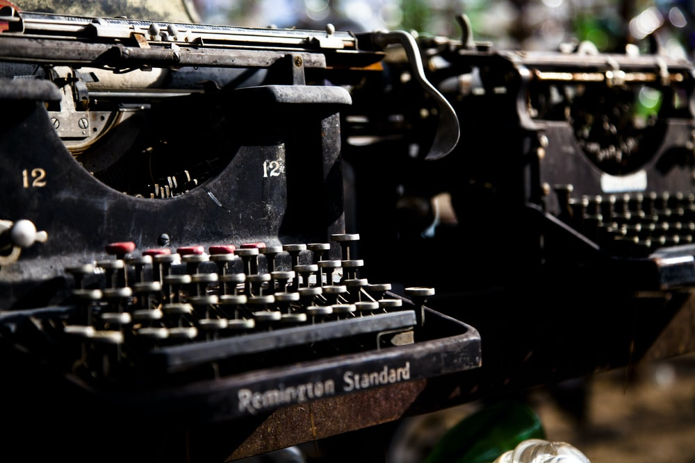 closeup photo of two typewriters