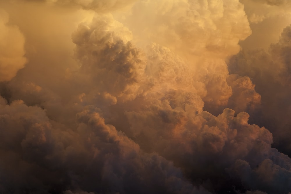 photo of white clouds during golden hour