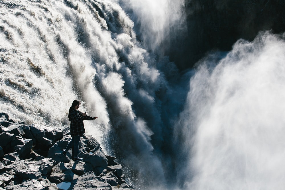 person standing waterfalls