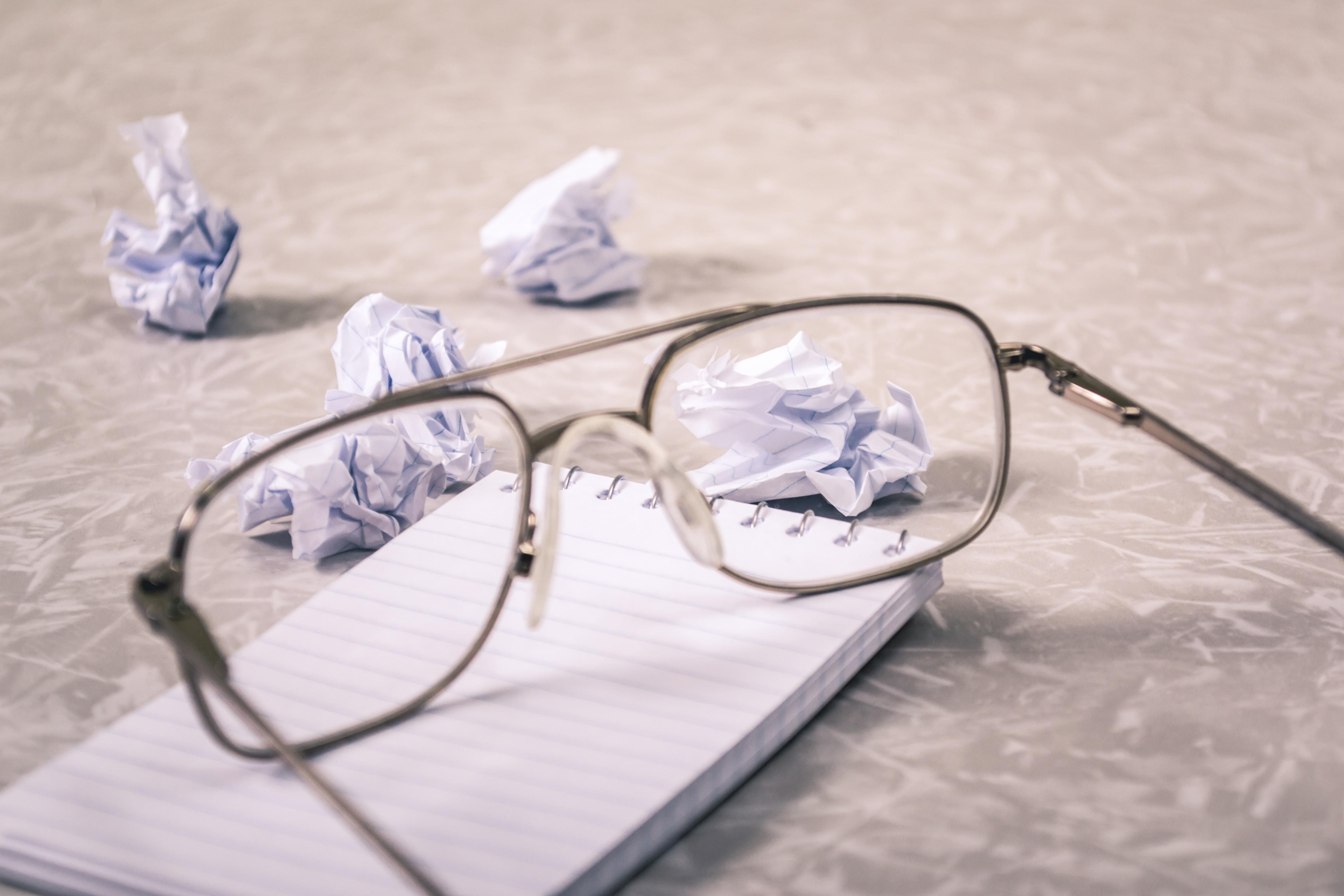 eyeglasses near on paper