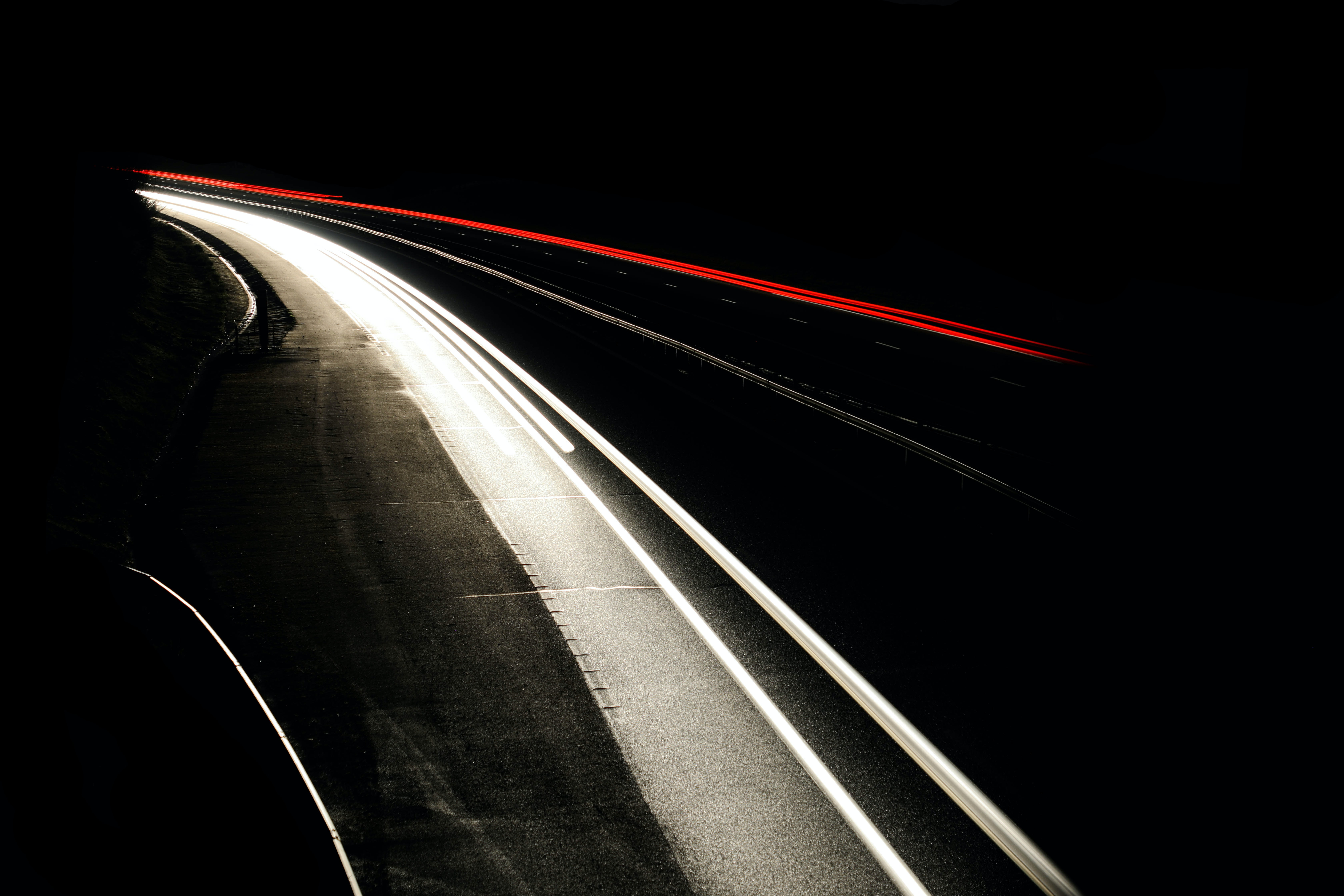 time lapse photography of vehicles on road during night