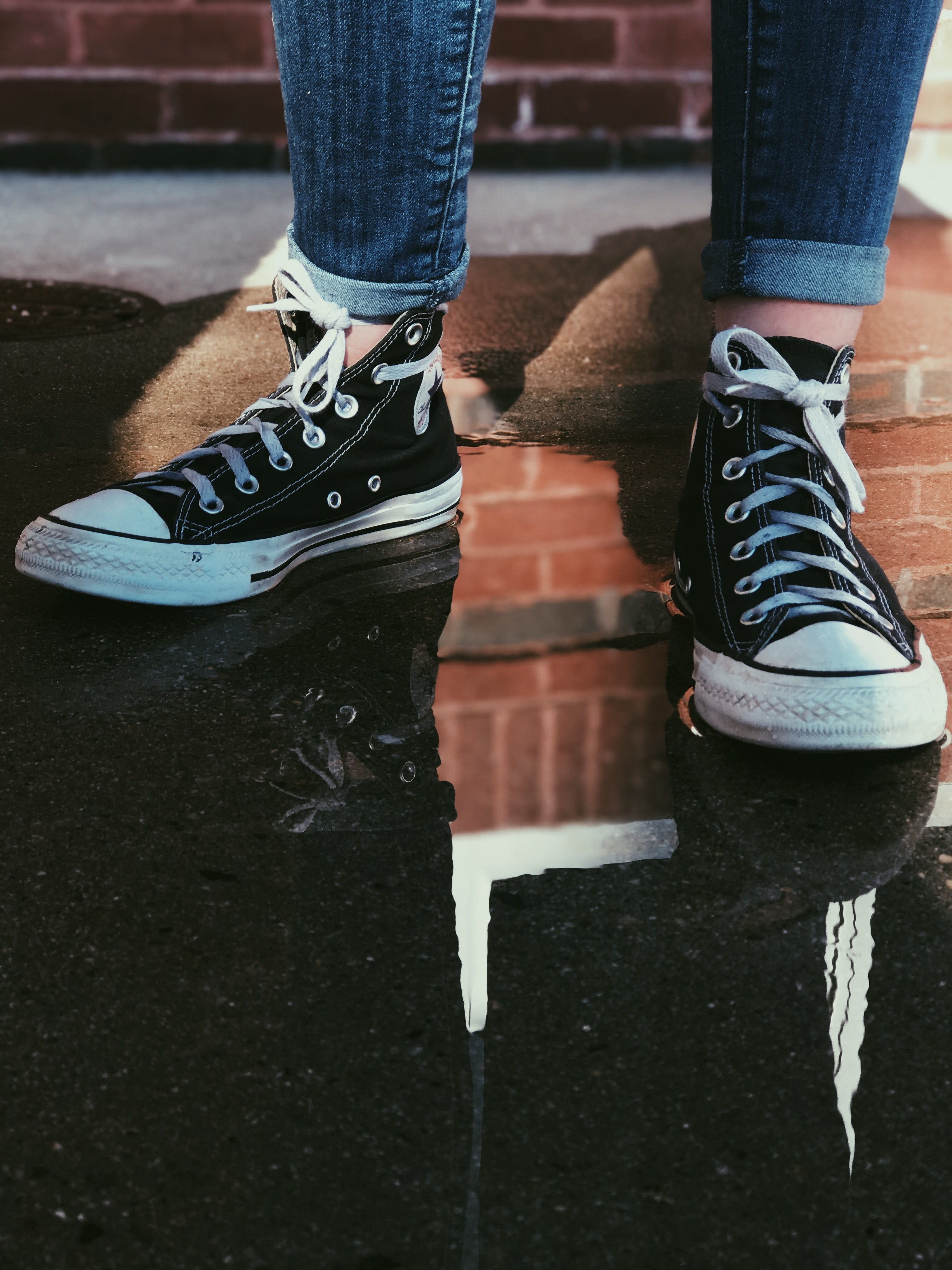 person wearing black high-top sneakers