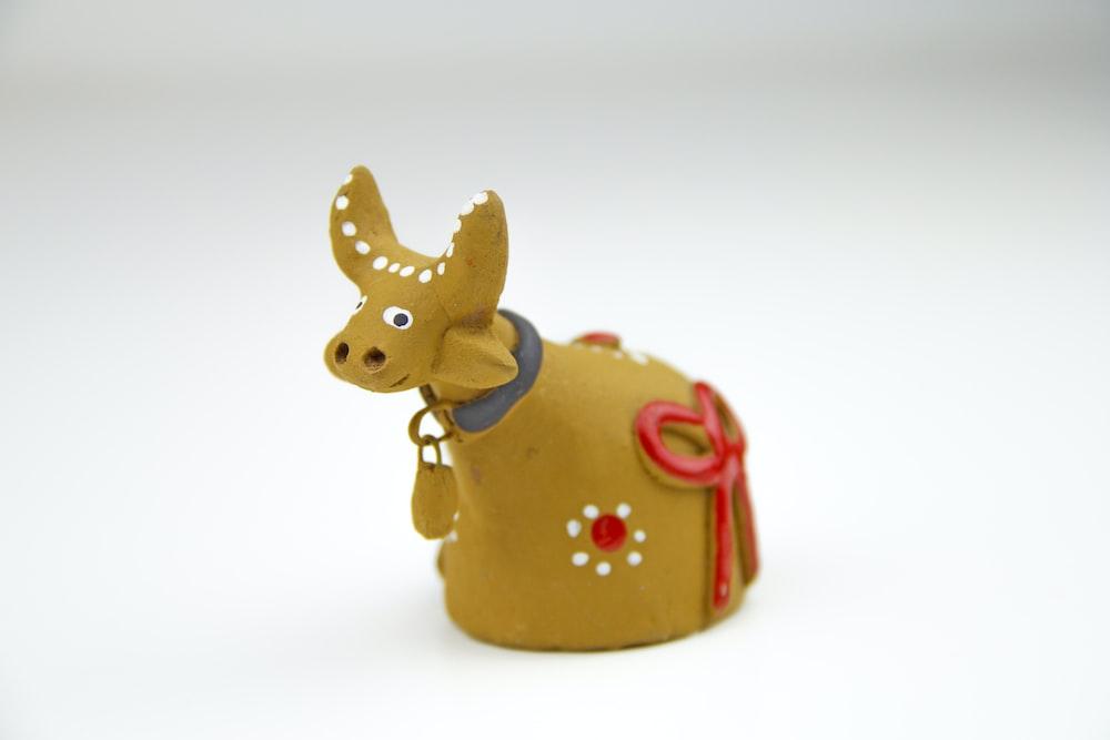 brown ceramic cow figurine