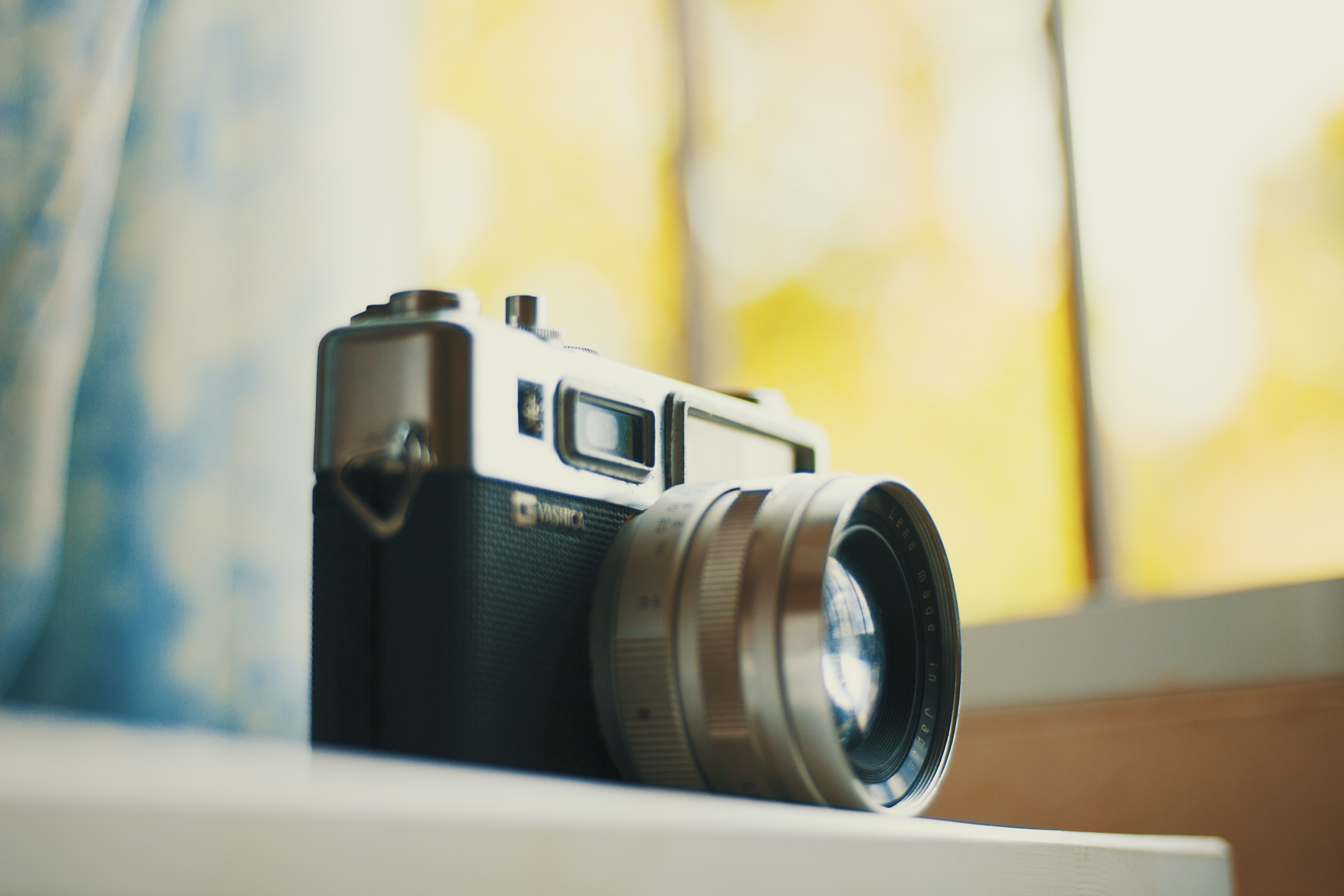 selective focus photography of black and grey DSLR camera on table