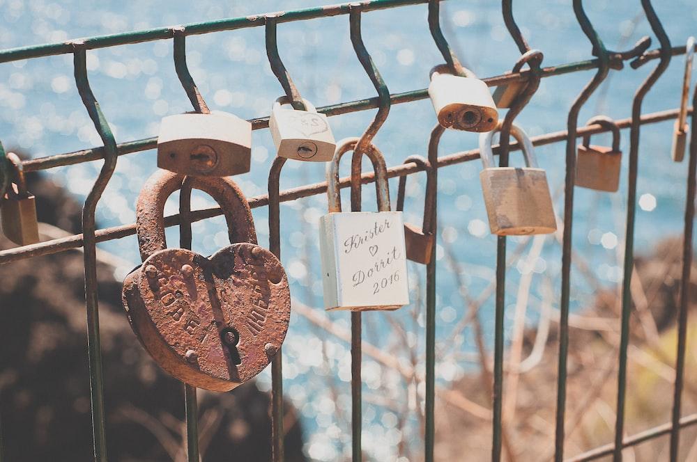 closeup photography of padlock at daytime