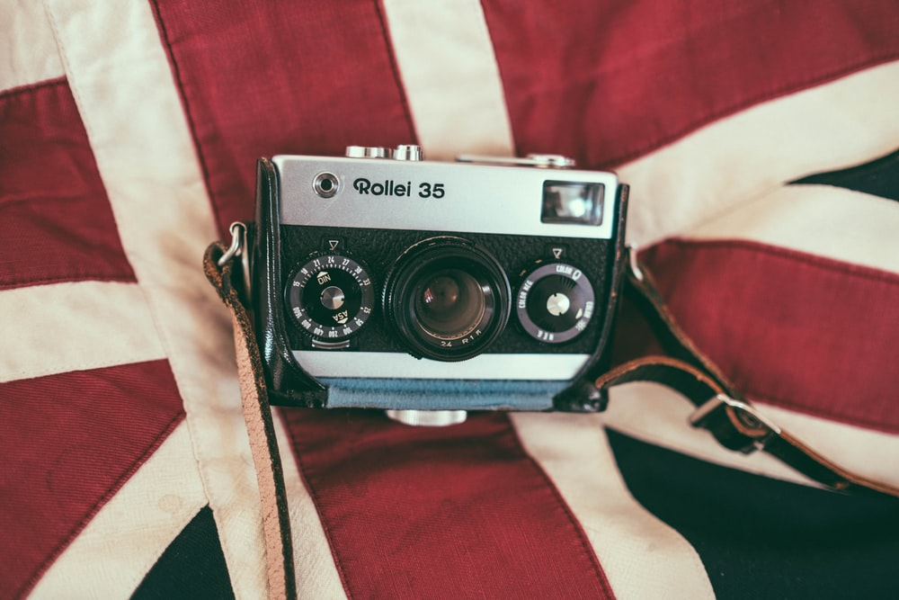 white and black camera on cloth
