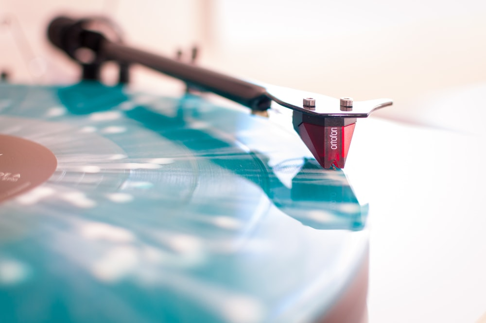 selective focus photo of blue and black turntable